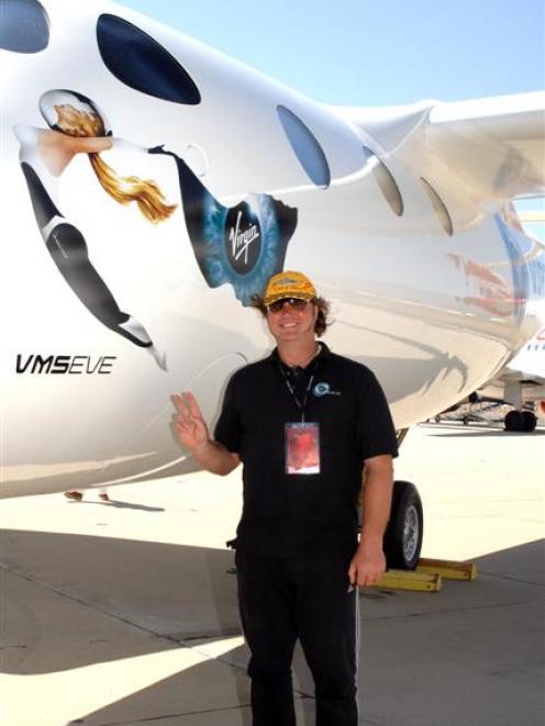 Makouri Scott, of Wanaka, alongside the mothership ''Eve'' at Mojave Spaceport, California, which...