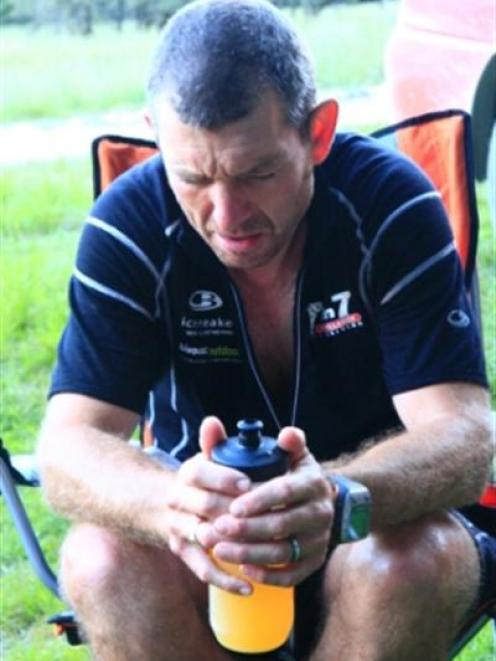 Mal Law enjoys a sit down and a cold drink after completing the Rees Dart circuit on day 5.