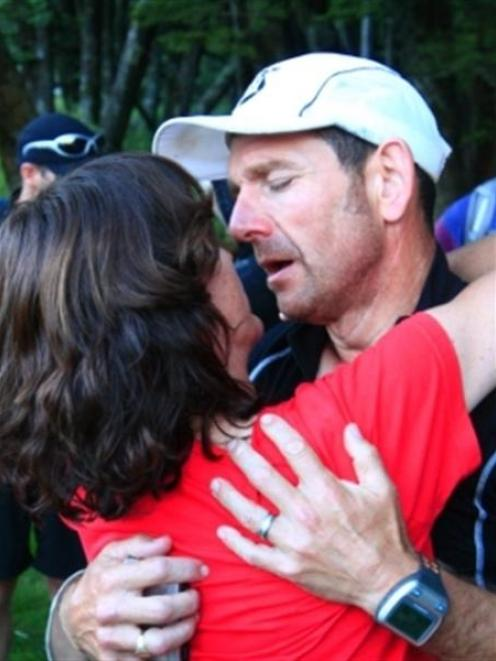 Mal Law gets a congratulatory hug from wife Sally on the same day.