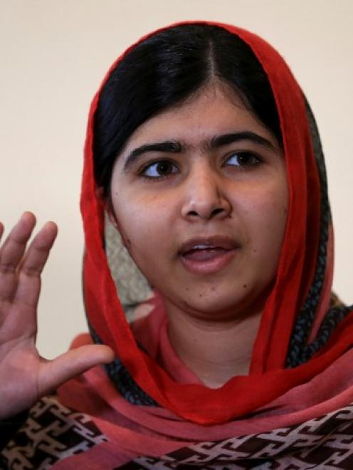 Malala Yousafzai speaks during a meeting with the leaders of the #BringBackOurGirls Abuja...
