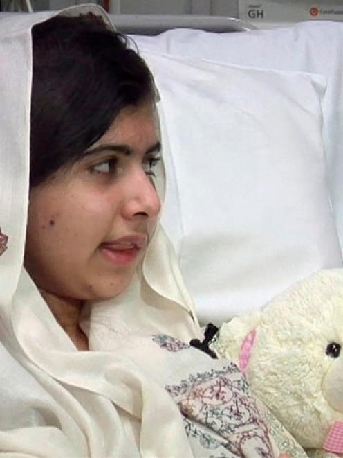 Malala Yousufzai, who was shot in the head by the Taliban for advocating girls' education, sits...