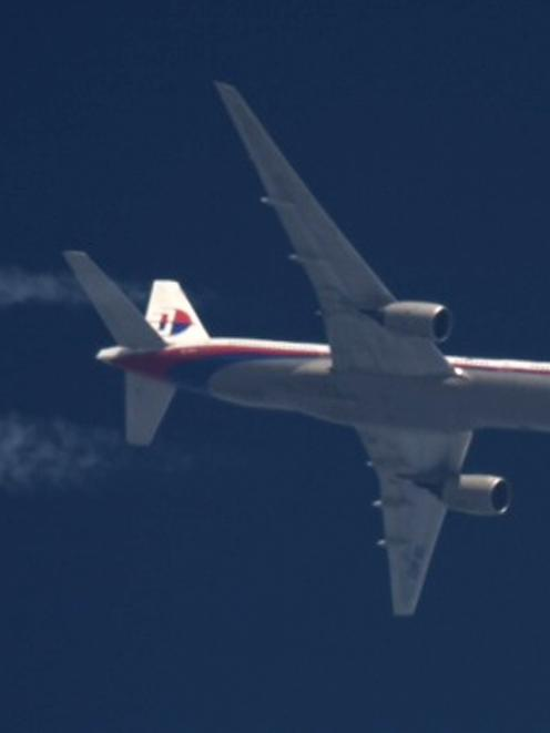 Malaysia Airlines Boeing 777 flight MH-17 with the registration number 9M-MRD flies over Poland...
