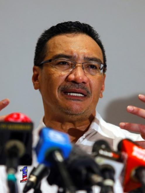 Malaysia's Acting Transport Minister Hishamuddin Hussein speaks at a news conference at Kuala...