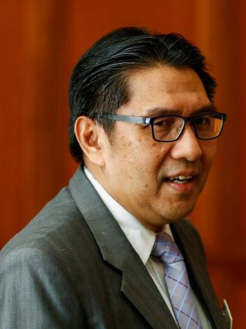 Malaysia's Department of Civil Aviation Director-General Azharuddin Abdul Rahman leaves after...
