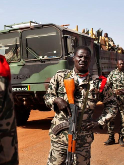Malian soldiers heading to Gao arrive in the recently liberated town of Douentza. REUTERS/Joe Penney
