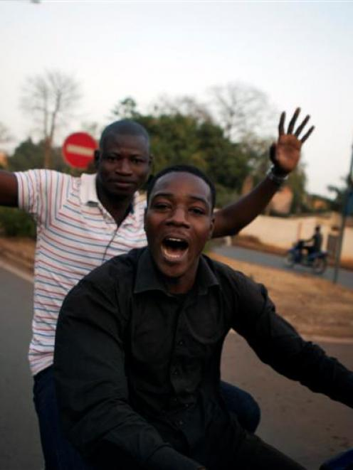 Malians celebrate on their motorcycles a visit by France's President Francois Hollande in Bamako,...