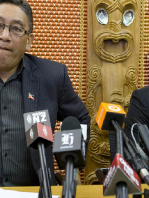 Mana Party leader Hone Harawira, left, and Internet Party chief executive Vikram Kumar announce...