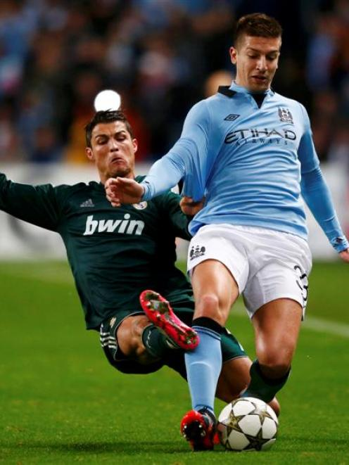 Manchester City's Matija Nastasic is challenged by Real Madrid's Cristiano Ronaldo.  REUTERS...