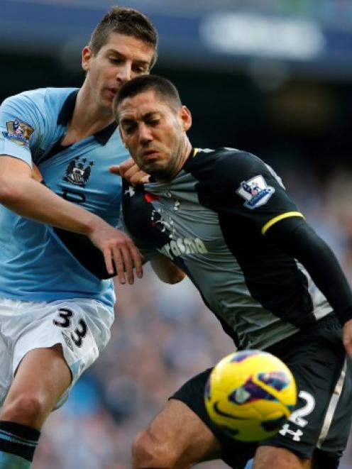Manchester City's Matija Nastasic (L) challenges Tottenham Hotspur's Clint Dempsey during their...