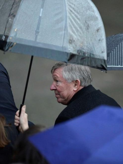 Manchester United manager Alex Ferguson attends the unveiling of a sculpture commemorating his...