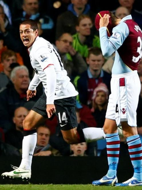 Manchester United's Javier Hernandez (L) celebrates his second goal next to Aston Villa's Matthew...