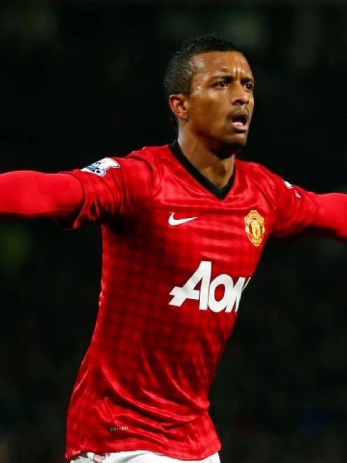 Manchester United's Nani celebrates after scoring his side's first goal against Reading during...