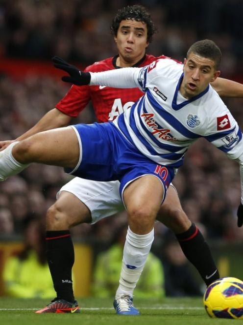 Manchester United's Rafael da Silva (back) challenges Queens Park Rangers' Adel Taarbat during...