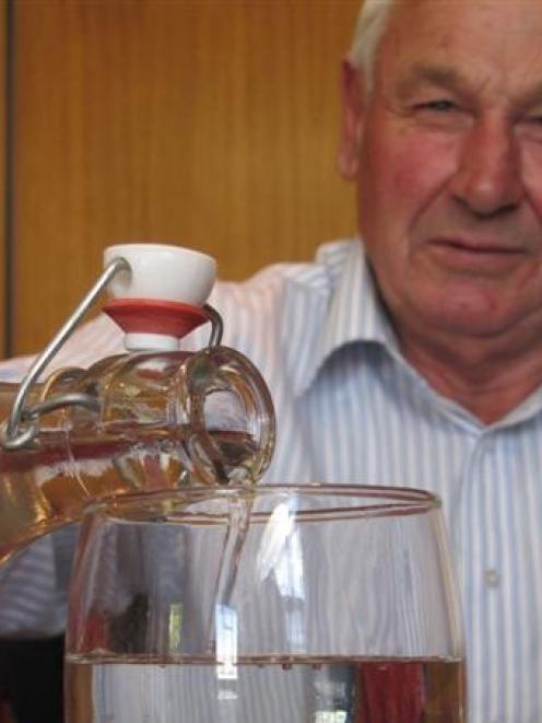Maniototo Community Board chairman Barry Becker pours a glass of water after the board discussed...