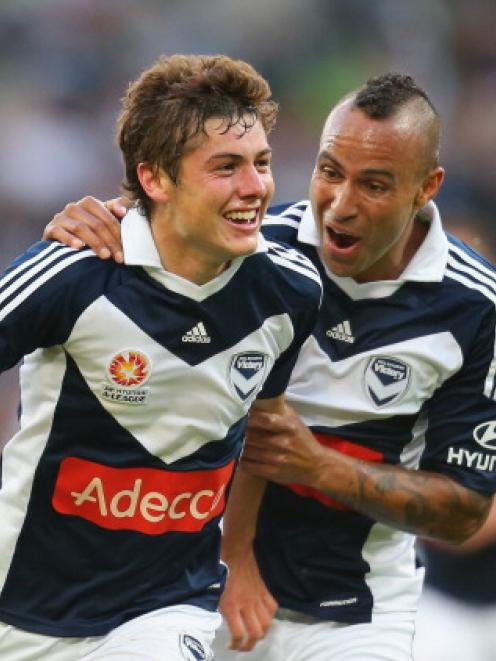 Marco Rojas (L) of the Melbourne Victory celebrates with Archie Thompson after scoring against...