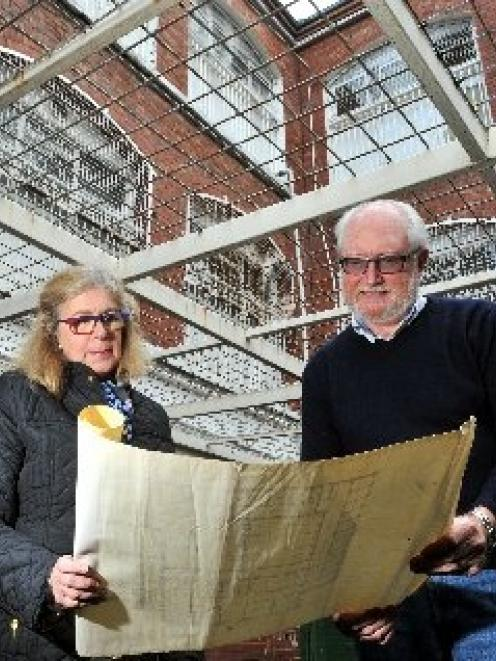 Margaret and Chris Betteridge survey an old layout plan of the historic Dunedin Prison, while...