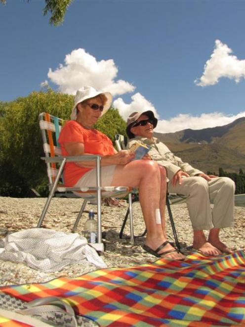 Margaret and Colin Dawson, of Dunedin, soak up the sun on the shores of Lake Wanaka yesterday....