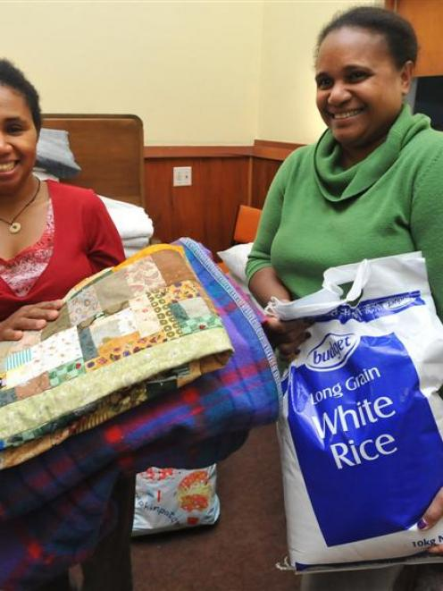 Maria Heutagi and Joy Breward, of Dunedin's Solomon Islands community, are pictured with food and...