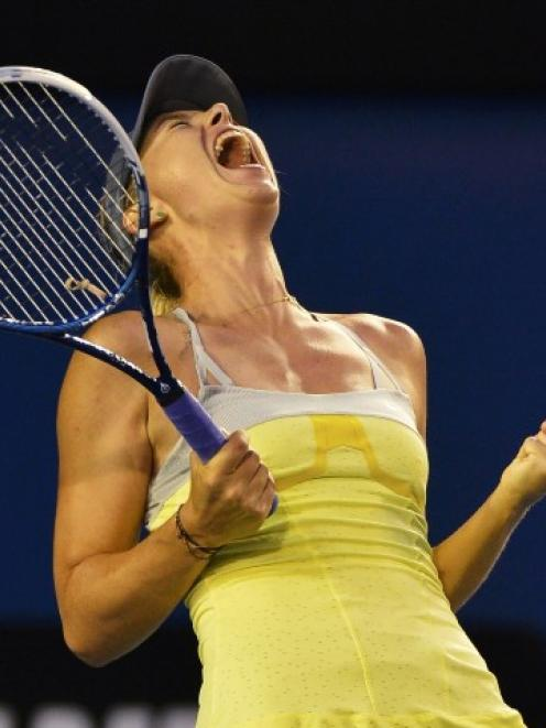 Maria Sharapova of Russia celebrates defeating Venus Williams of the US in their women's singles...