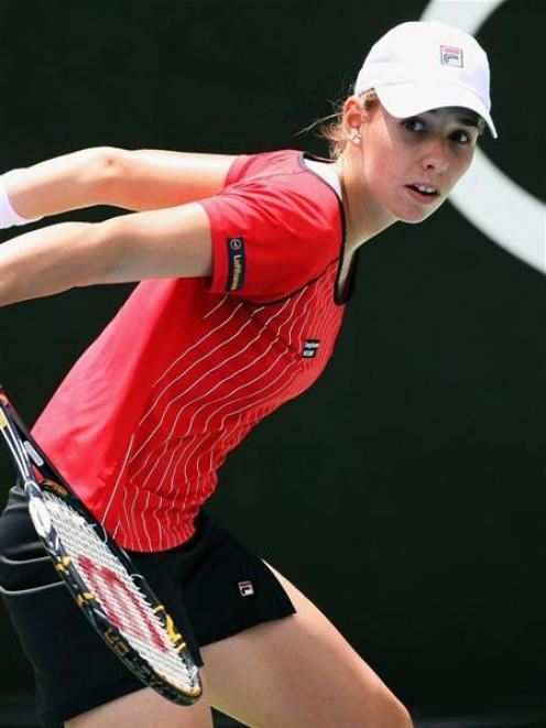 Marina Erakovic, of New Zealand, plays a backhand during her match against Nuria Llagostera Vives...