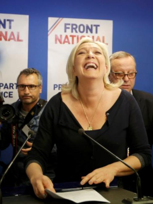 Marine Le Pen, France's National Front political party head, reacts to results after the polls...