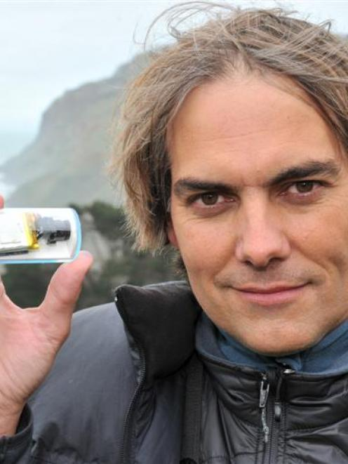 Marine scientist Dr Thomas Mattern, at Boulder Beach, with one of his innovative video cameras...