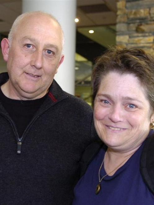 Mark and Sarah Stewart arrive back at Dunedin International Airport on Saturday after the...