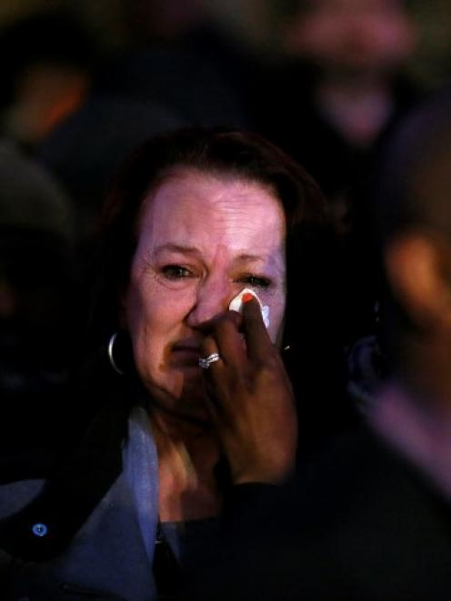 Mark Duggan's mother, Pamela Duggan, has her tears wiped as she stands outside the High Court in...