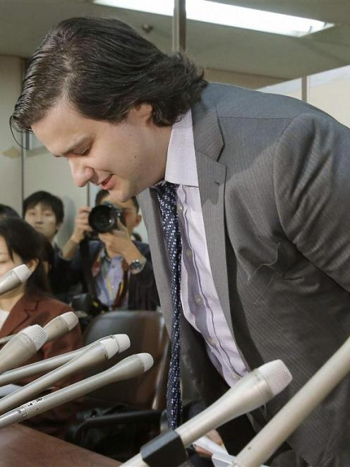 Mark Karpeles, chief executive of Mt Gox, bows at the start of a news conference at the Tokyo...