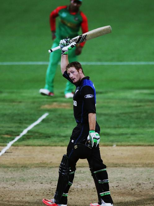 Martin Guptill of New Zealand celebrates after scoring a century during the 2015 ICC Cricket...