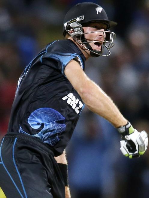 Martin Guptill of New Zealand celebrates the winning runs. REUTERS/Nigel Marple