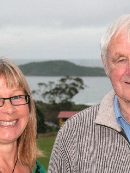 Martin Palmer and his daughter Robyn Ashton stand in front of Moturata/Taieri Island. They have...