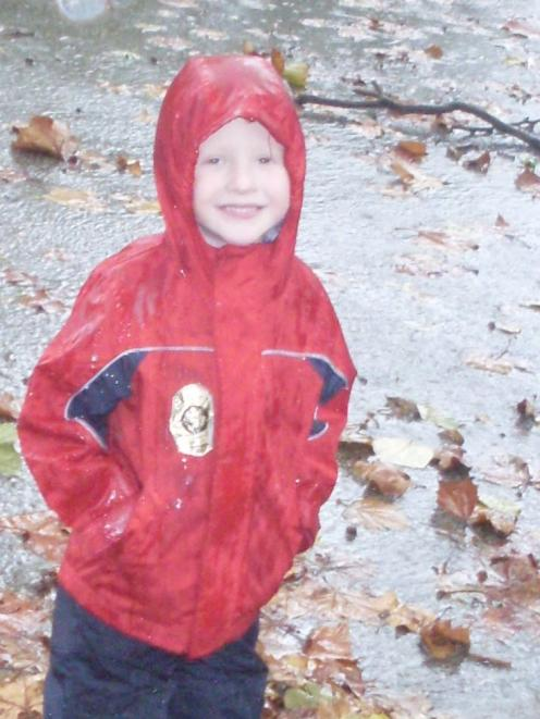Matthew Dober (4), the son of former Dunedin woman Sandra Mooney, braves the wild weather near...