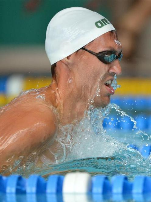 Matthew Glassford competes in the men's 17 and over 100m breaststroke at Moana Pool yesterday....