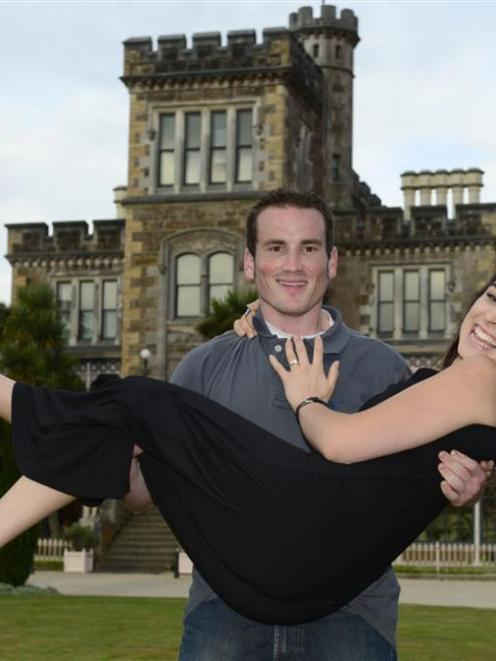 Matthew Weathers holds his fiance, Fleur Allen, after proposing at Larnach Castle on Saturday....