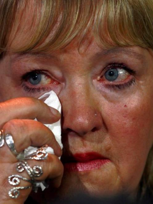 Maureen Sullivan, who worked in a 'Magdalene Laundry', wipes a tear during a 'Magdalene Survivors...