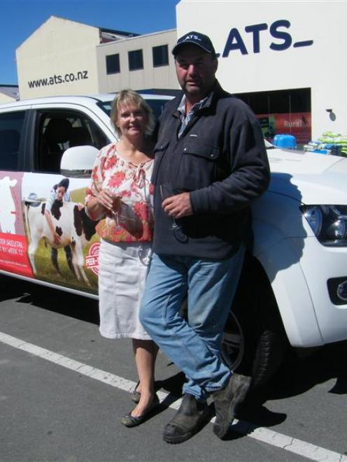 Maxine and Evan Chisnall toast their good luck after winning a Volkswagen Amarok ute in a...
