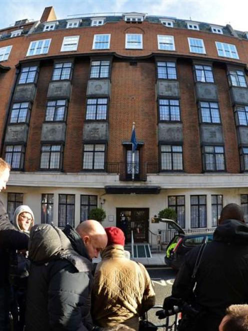 Media wait outside the King Edward VII hospital.  REUTERS/Toby Melville