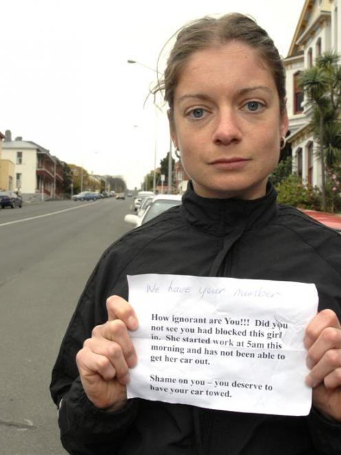 Megan Balchin displays the message she received from an angry motorist after returning to her car...