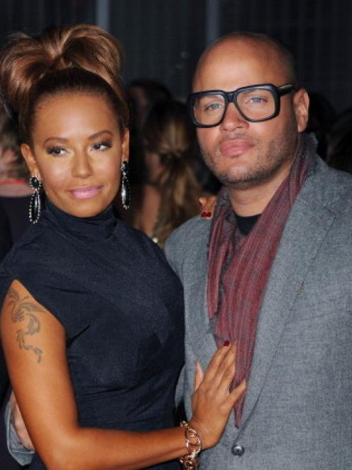 Mel B and Stephen Belafonte attend the premiere of The Hunger Games at O2 Arena in London, in...