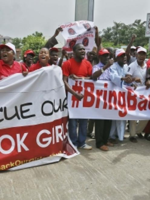 Members of the #BringBackOurGirls campaign group protest on a street, after challenging the...