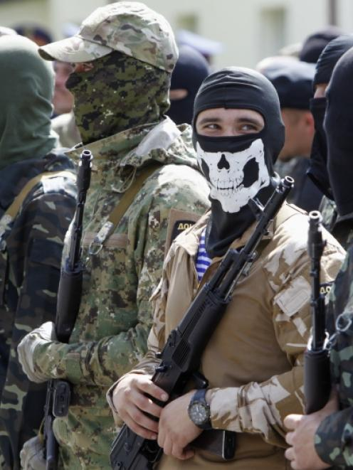 """Members of the """"Donbass"""" self-defence battalion attend a ceremony to swear the oath to be..."""