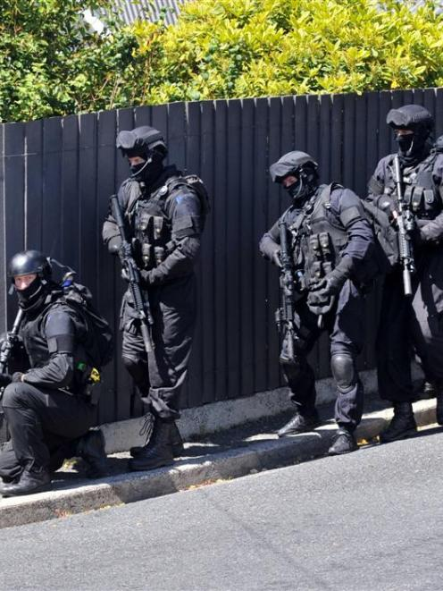 Members of the Dunedin armed offenders squad outside a Dunedin property earlier this year. Photo...