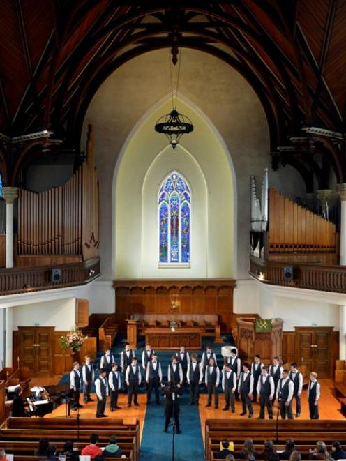 Members of the Otago Boys' High School choir Mandate perform under the musical direction of...