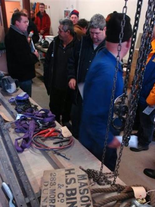 Members of the public inspect masonry equipment during the Bingham and Co liquidation auction in...