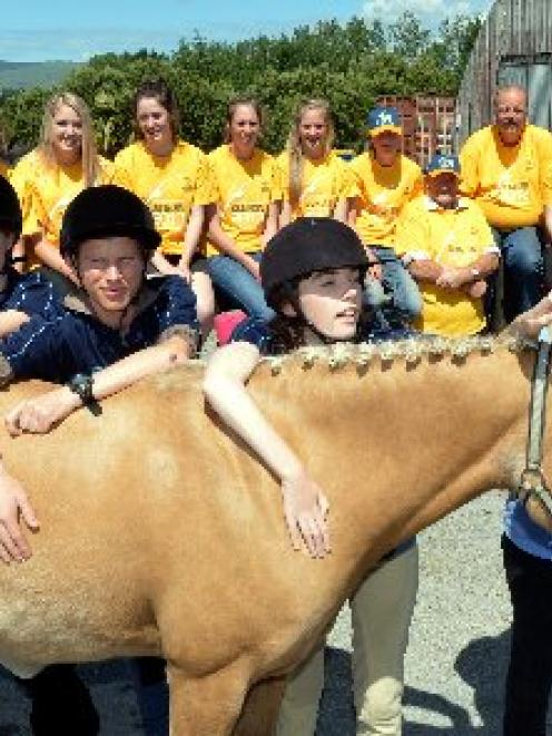 Members of the Wanaka Riding for the Disabled team introduce themselves to Owaka horse Throwa at...