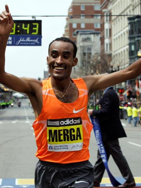 Mens winner Deriba Merga of Ethiopia reacts at the finish line in Boston at the 113th running of...