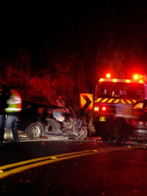 mergency service personnel attend the scene of a head-on crash at the top of the Kaimai Ranges...