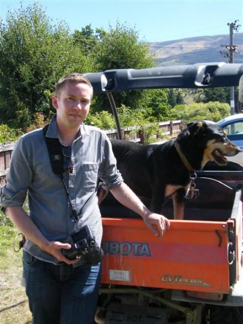 merican photographer Andrew Fladeboe with dog Ned, on Jack and Claire Davis' farm in Lowburn. ...