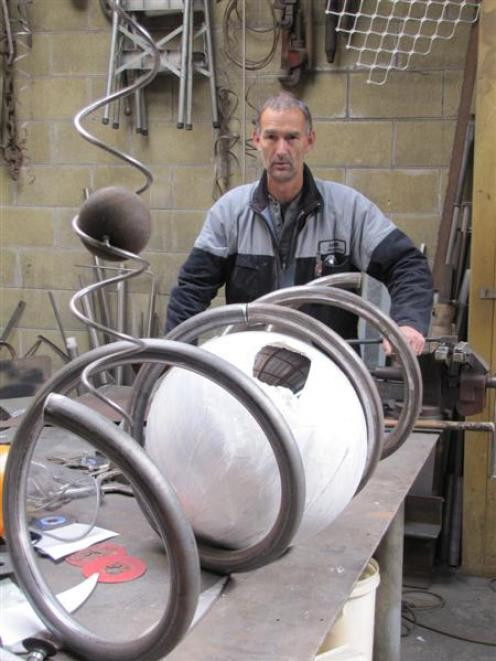 Metalworks Wanaka Ltd owner Ernie Maluschnig creates a new sculpture for Stuart Landsborough's...